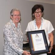 AARE President Debra Hayes presenting an Honorary Life Membership to Professor Robert Hattam (accepted by Robyne Garrett)